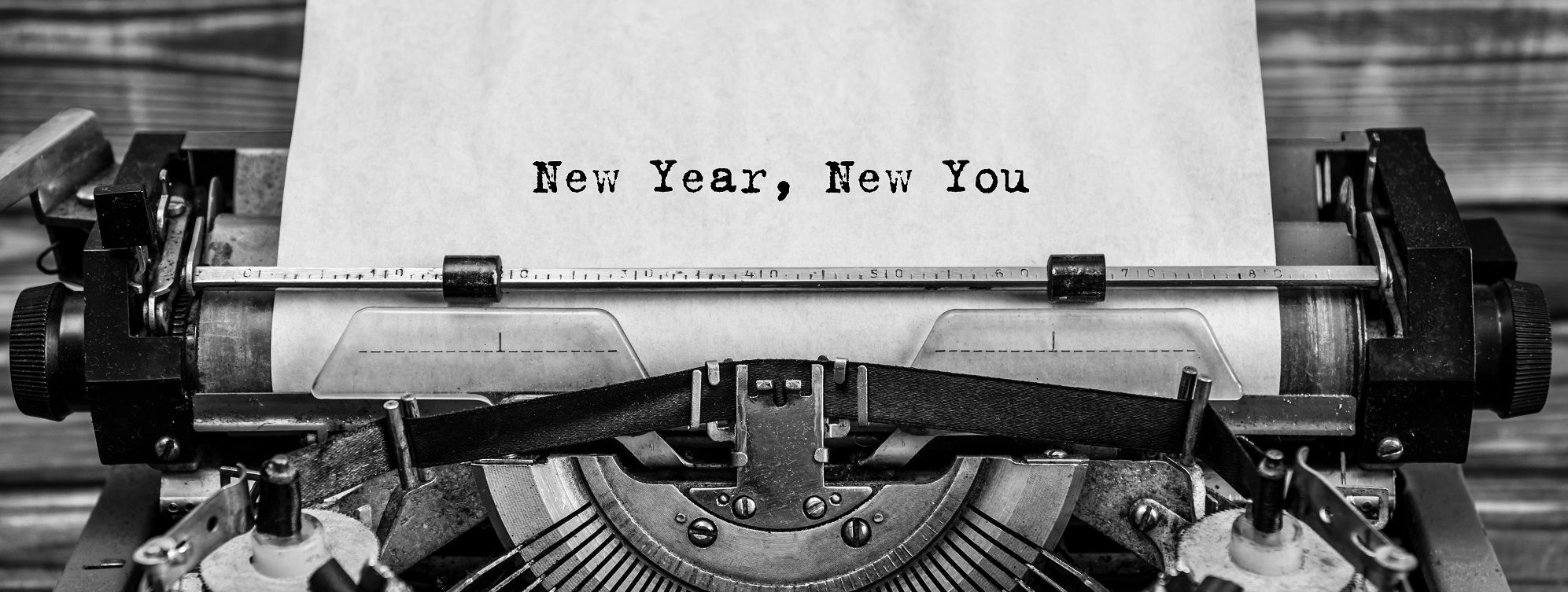 typewriter with new year new you text on the paper
