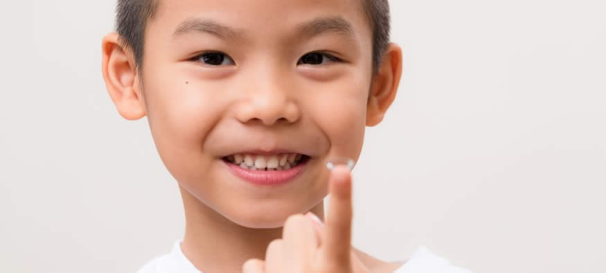 child with contact lenses