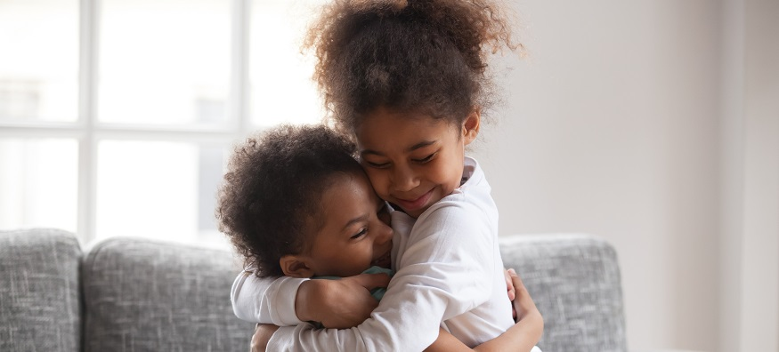 a woman hugging her daughter