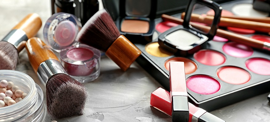 makeup products scattered on a table