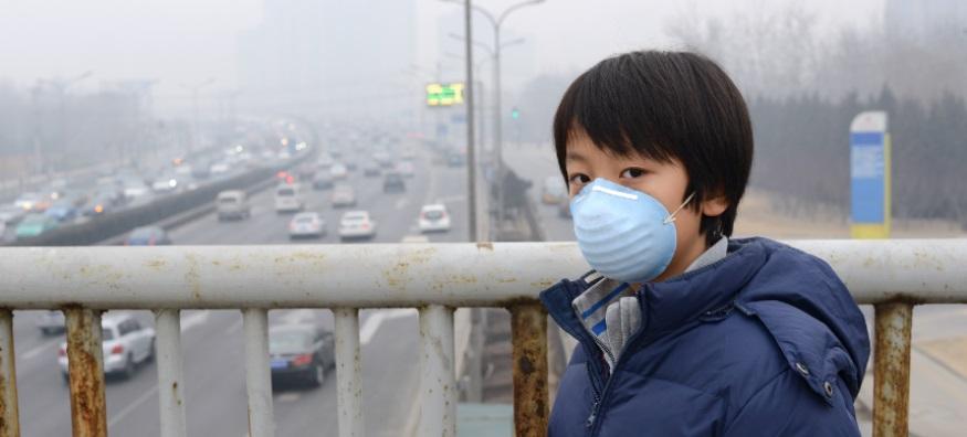 Boy wearing a pollution mask in Beijing