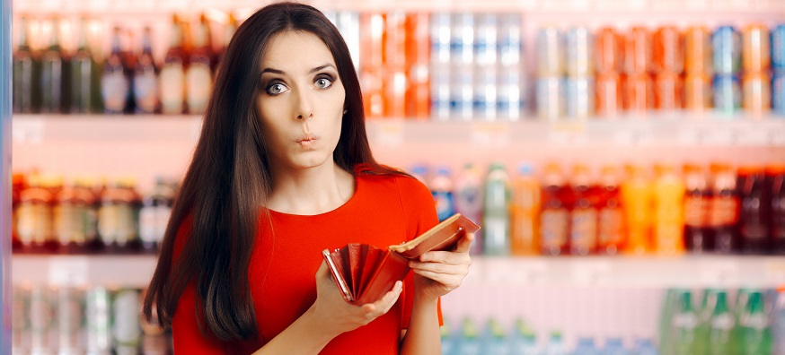 a woman looking surprised at her empty wallet