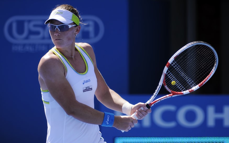 sam stosur wearing sunglasses and playing tennis