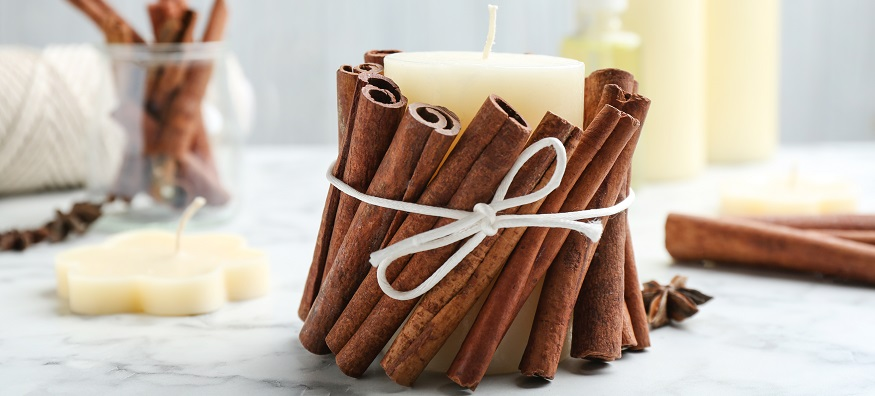 a homemade candle wrapped in cinnamon sticks