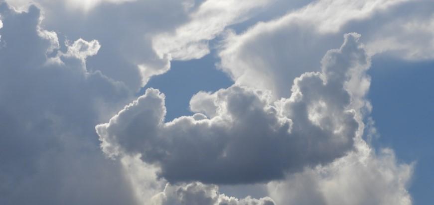 teddy bear on back of cloud